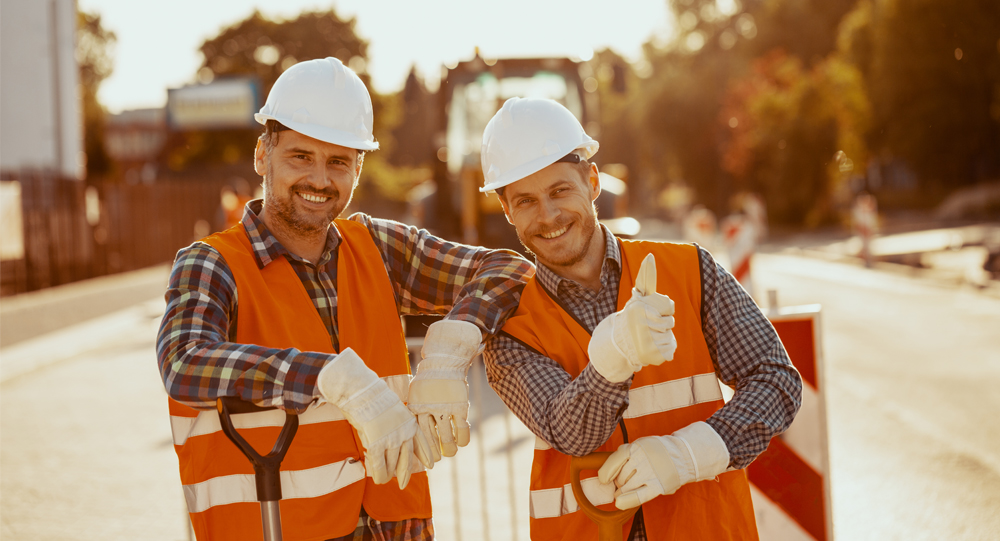 Two construction workers taking a photo