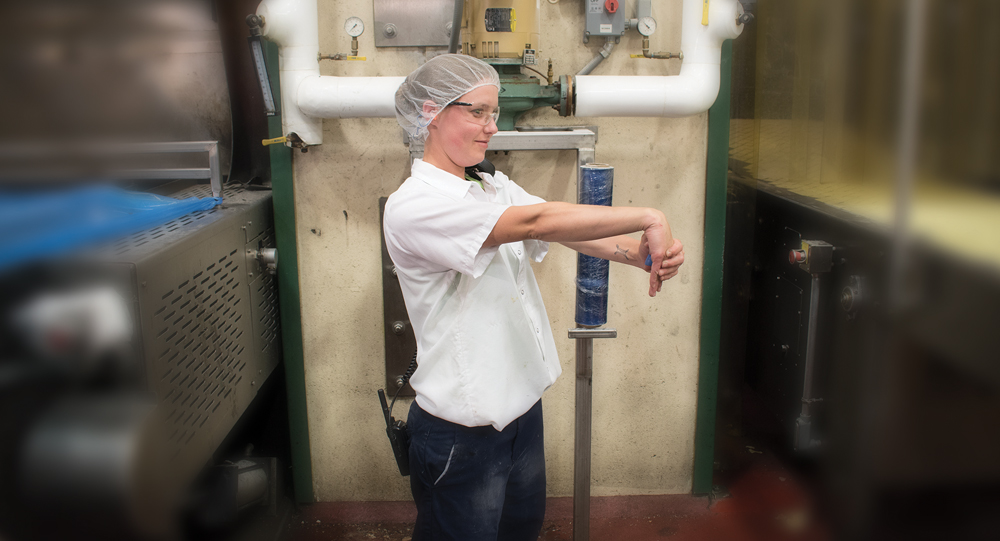 Employee performing wrist stretch in an industrial setting