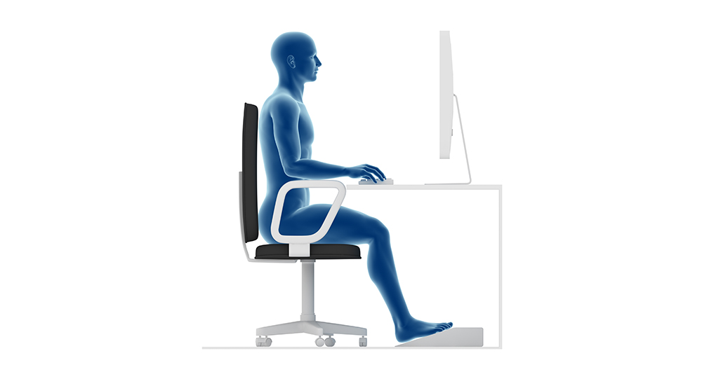 Proper posture to sit and work on office desk
